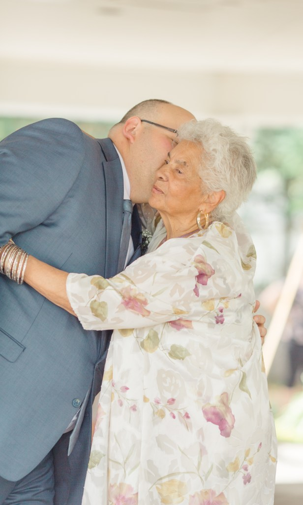Kiss of Good Luck from Nanny - Groom- Ideas for what to wear for Wedding Photography, Modern Wedding Inspiration. Romantic Micro Wedding Orchard view - Grey Loft Studio is Ottawa's Wedding and Engagement Photographer for Real couples, showcasing photos that are modern, bright, and fun. Petite Wedding, Elopement Wedding, COVID Wedding Inspiration 2020