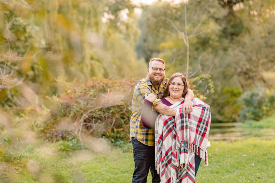 Cute pose with blanket-Fall Session - Engagement Session - Ottawa Wedding Photographer - Grey Loft Studio - Wedding in Ottawa - Yellow & Plaid with Burgundy Knit Sweater and Jeans