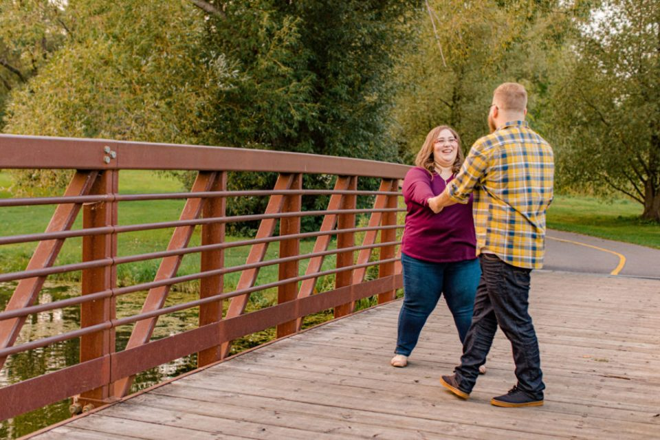 Ring around the Rosy Pose- Engagement Session - Ottawa Wedding Photographer - Grey Loft Studio - Wedding in Ottawa - Yellow & Plaid with Burgundy Knit Sweater and Jeans