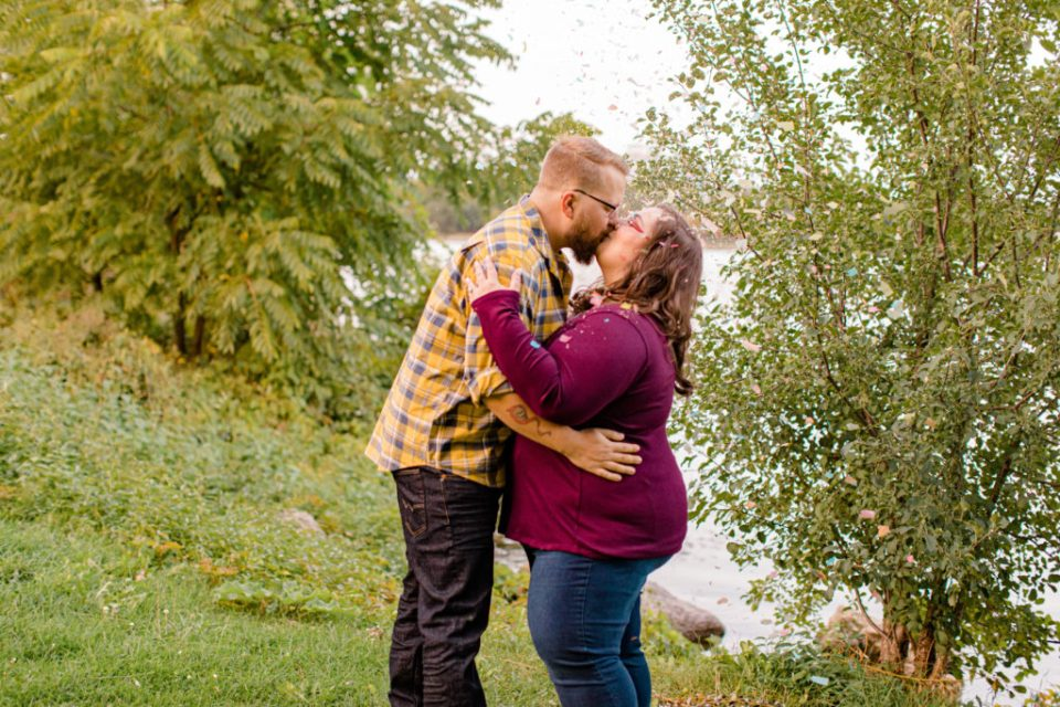 Confetti Kiss during an Engagement Session - Ottawa Wedding Photographer - Grey Loft Studio - Wedding in Ottawa -  during Photo Session Yellow & Plaid with Burgundy Knit Sweater and Jeans