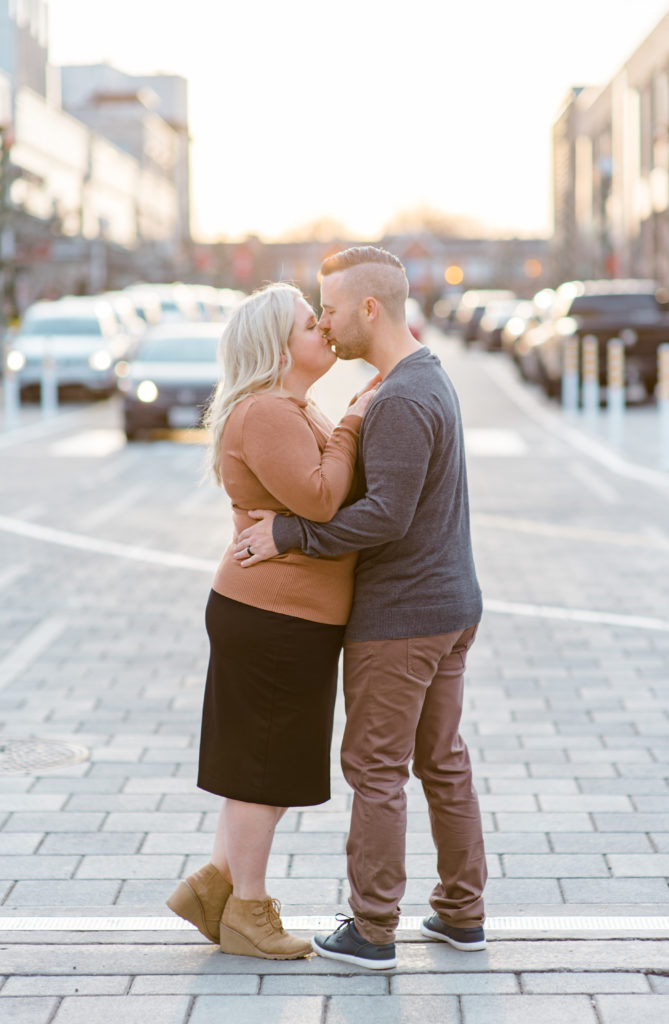 Do You Want to Build a Business With Your Partner? man and woman also husband and wife walking on grass in downtown Ottawa on the street wearing brown cardigan and pants and a black skirt with the sun behind them - Posing Ideas - Poses - Couple kissing - Couple kissing picture