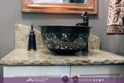copper vessel sink split granite countertop