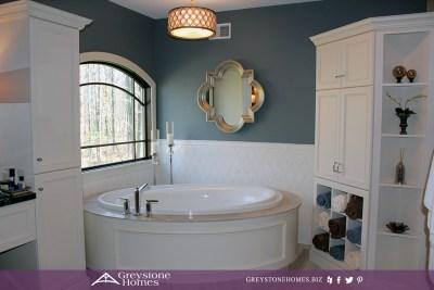 traditional bathroom freestanding bathtub harlequin tile