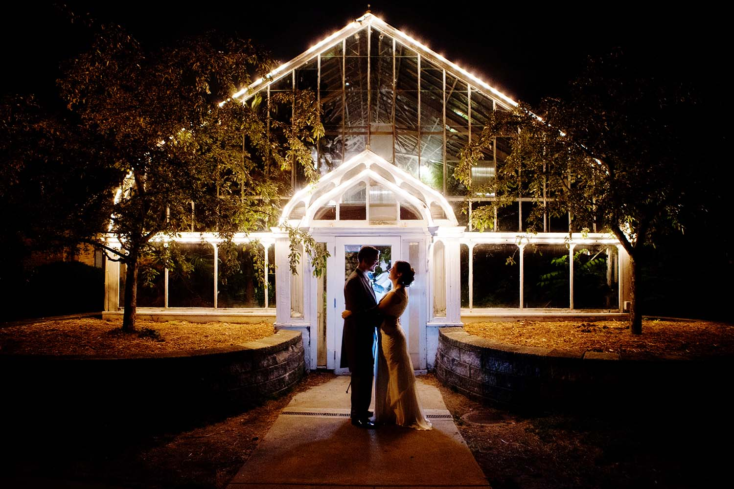Glass Green house night wedding portrait