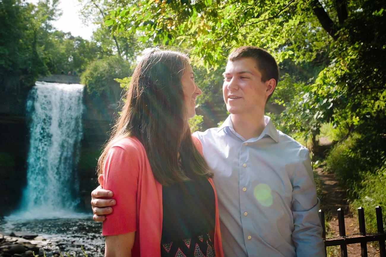 Minnehaha Falls Engagement Photography Couple sun flare. Twin Cities Engagement Photographers engagement photos Minneapolis
