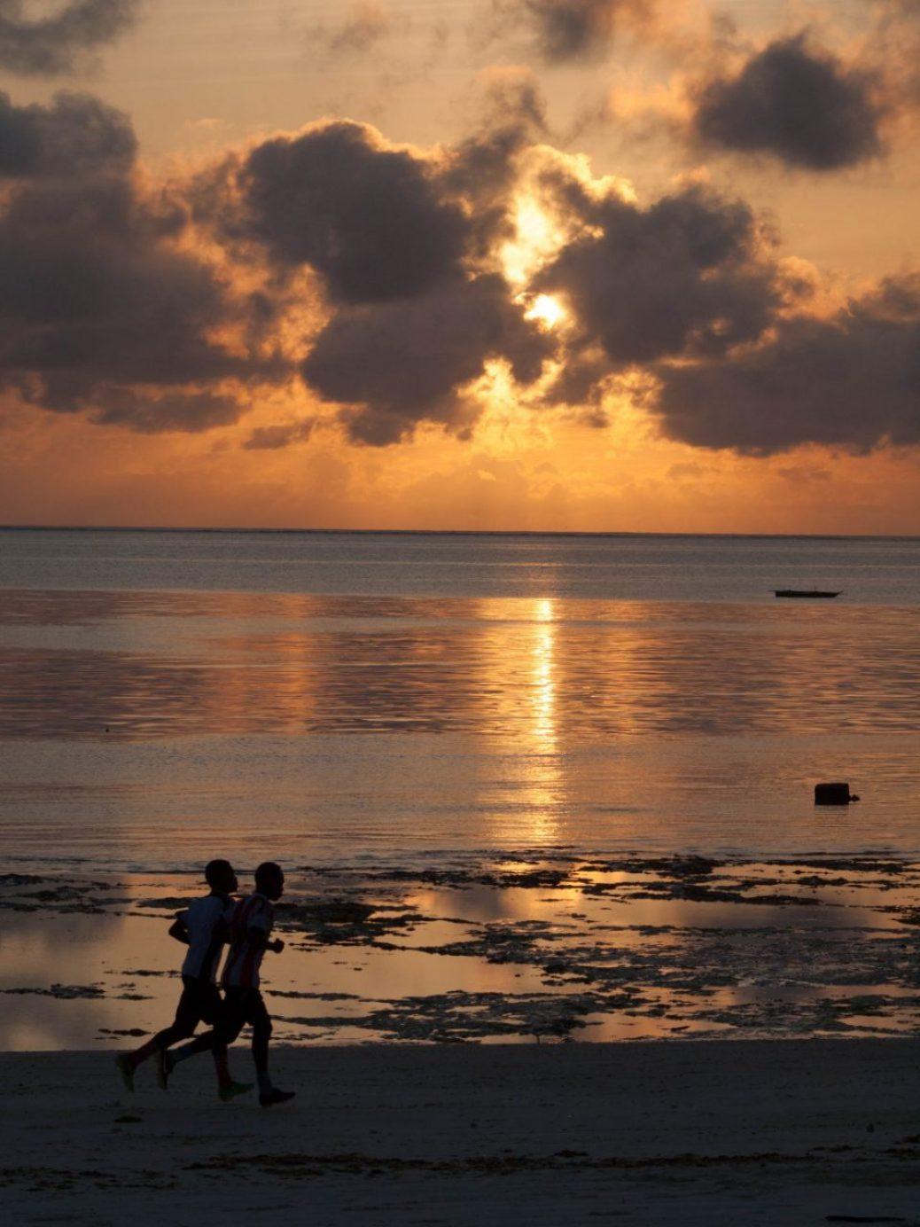 Sunset with Joggers in Zanzibar
