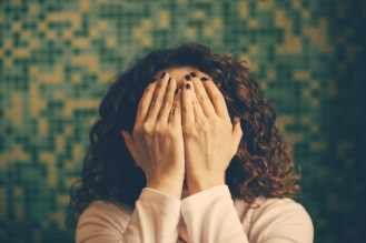 crying Woman hiding face