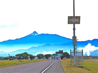 Driving along the Carretera to the beach. Colima Volcano is front and center.
