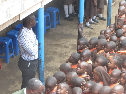 The head teacher of the school rallies the students.