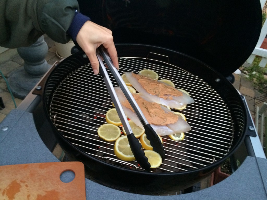 fish grilled on a bed of lemons