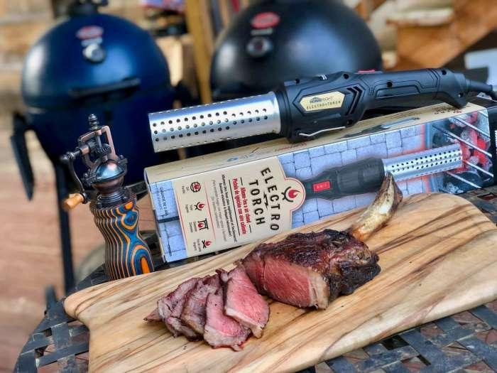 Sliced, rare tomahawk steak on a cutting board