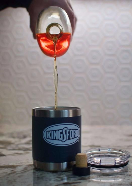 Whiskey pouring into a Yeti tumbler