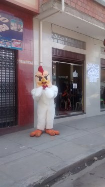 This fried chicken shop hired a mascot to draw in the crowds. source: gringoinbolivia