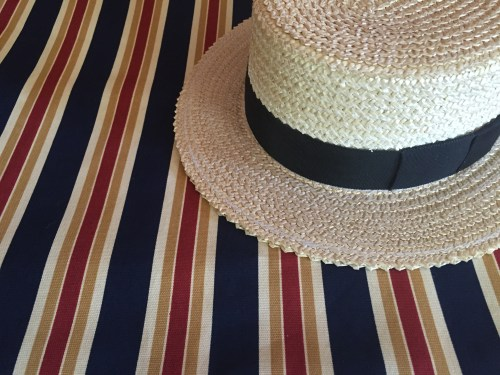 Photo of blazer fabric and boater hat