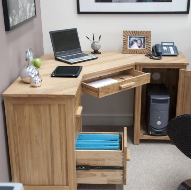 Wooden corner desk setup