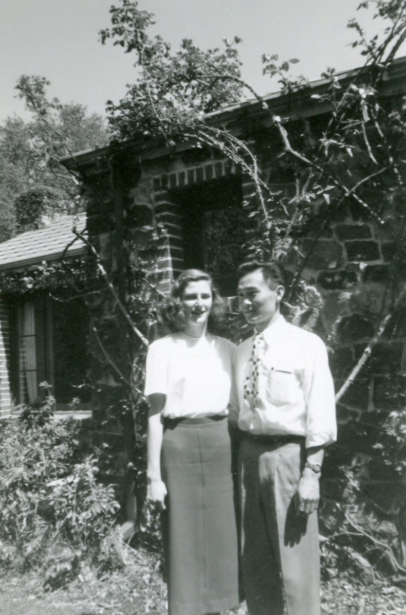 A black and white photo of Dorothy Walker and Joe Kamaya in front of their Berkeley house in 1949