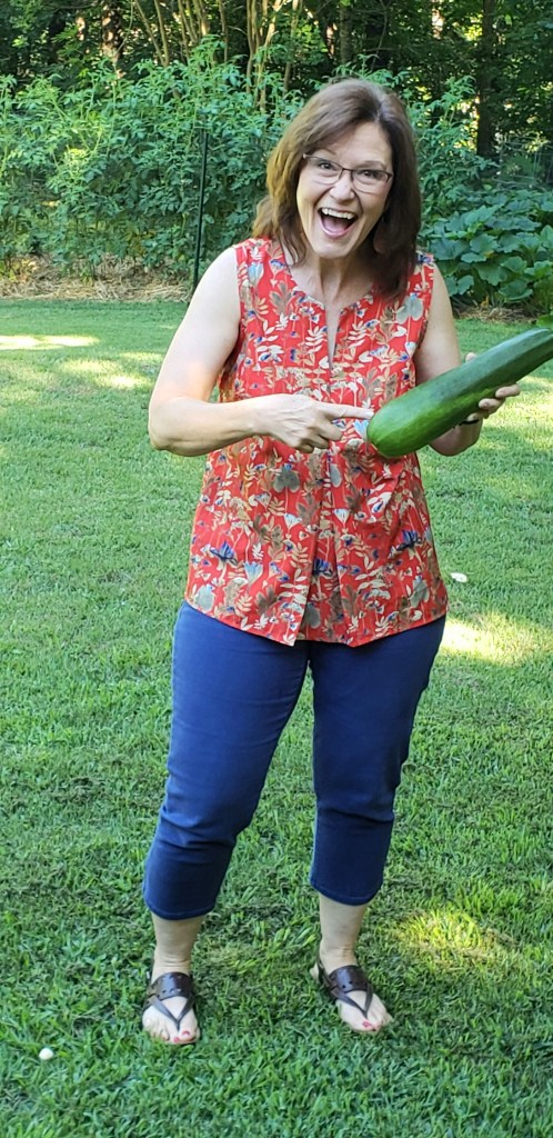 Kathleen Royal Phillips holding zucchini as big as a baseball bat
