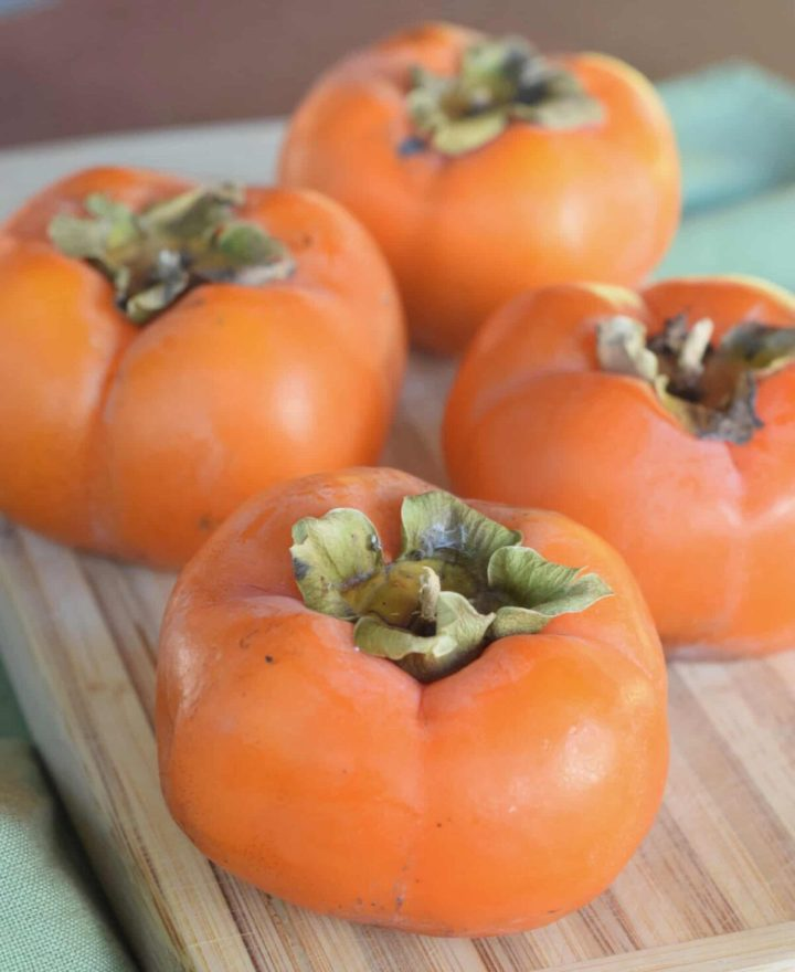 Four Fuyu persimmons close up