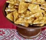 Peanut Brittle a wooden cake stand.