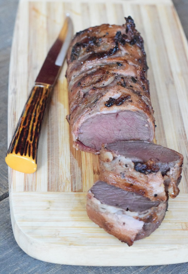Bacon-Wrapped Venison Backstrap Roast is worthy to grace your holiday table.