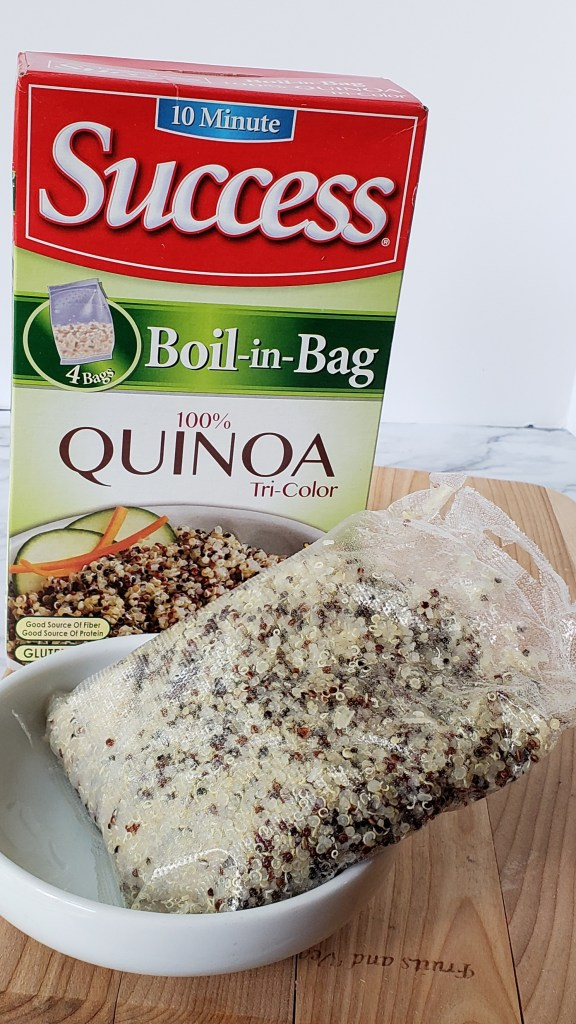 tri color quinoa boil in bag package with cooked package in a bowl