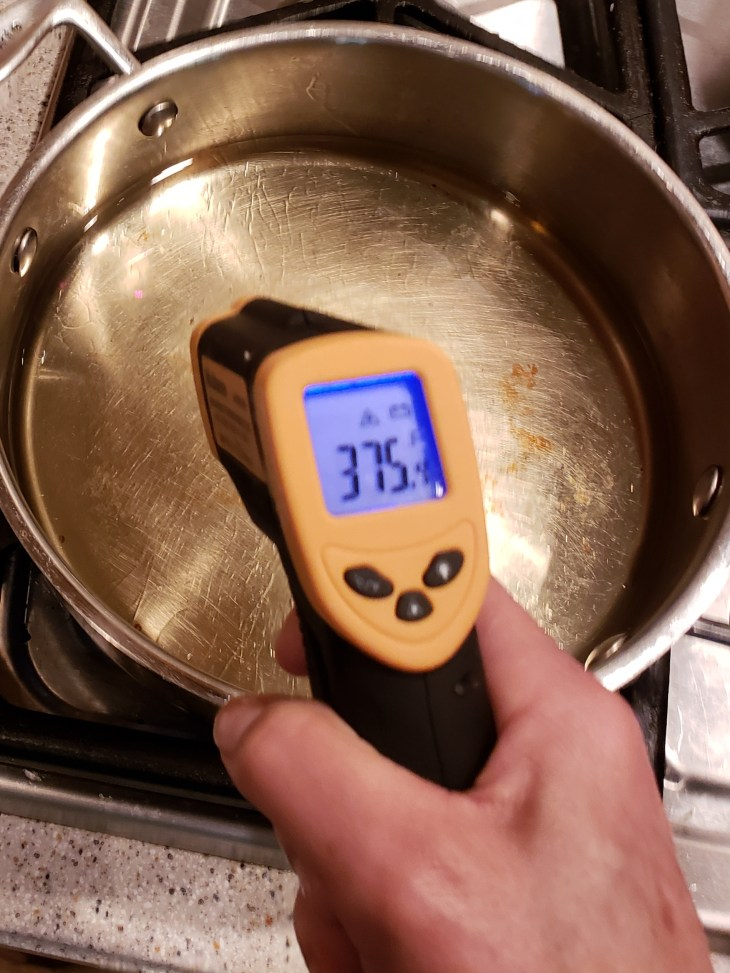 Thermal thermometer registering 375 degrees over hot oil