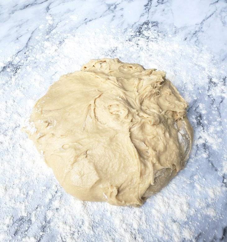 Cinnamon Roll dough on floured marble surface