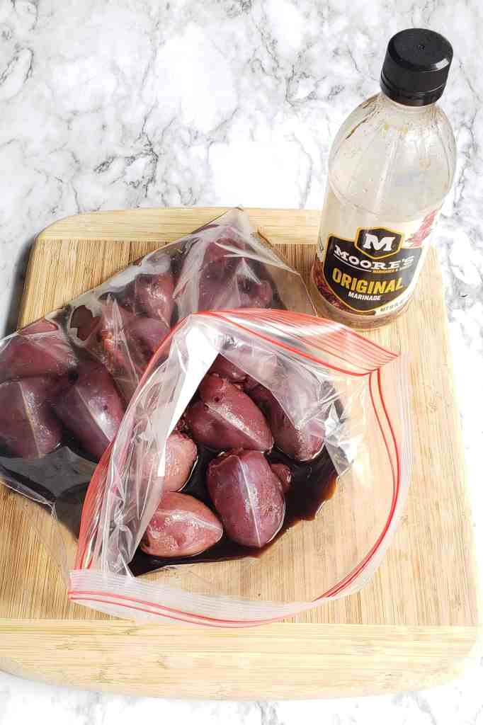 Marinating dove breasts in Moores sauce in a zip top bag