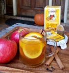 clear mug of hot tea with orange slice