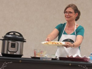 Kathleen Phillips having fun at her Holiday Cooking Show demonstrating Instant Pot Turkey Breast and Gravy
