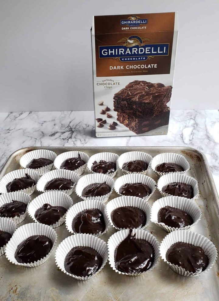 Ghiradelli brownie mix box and batter in mini muffin paper liners.