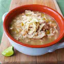 Shortcut White Bean Chicken Chili has all the flavor of slow cooked beans and chicken but uses canned beans so you can get dinner on the table quicker!