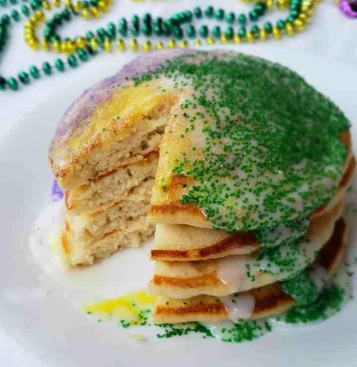 King Cake Pancakes made are shortcut banana pancakes made to celebrate Fat Tuesday during Mardi Gras.