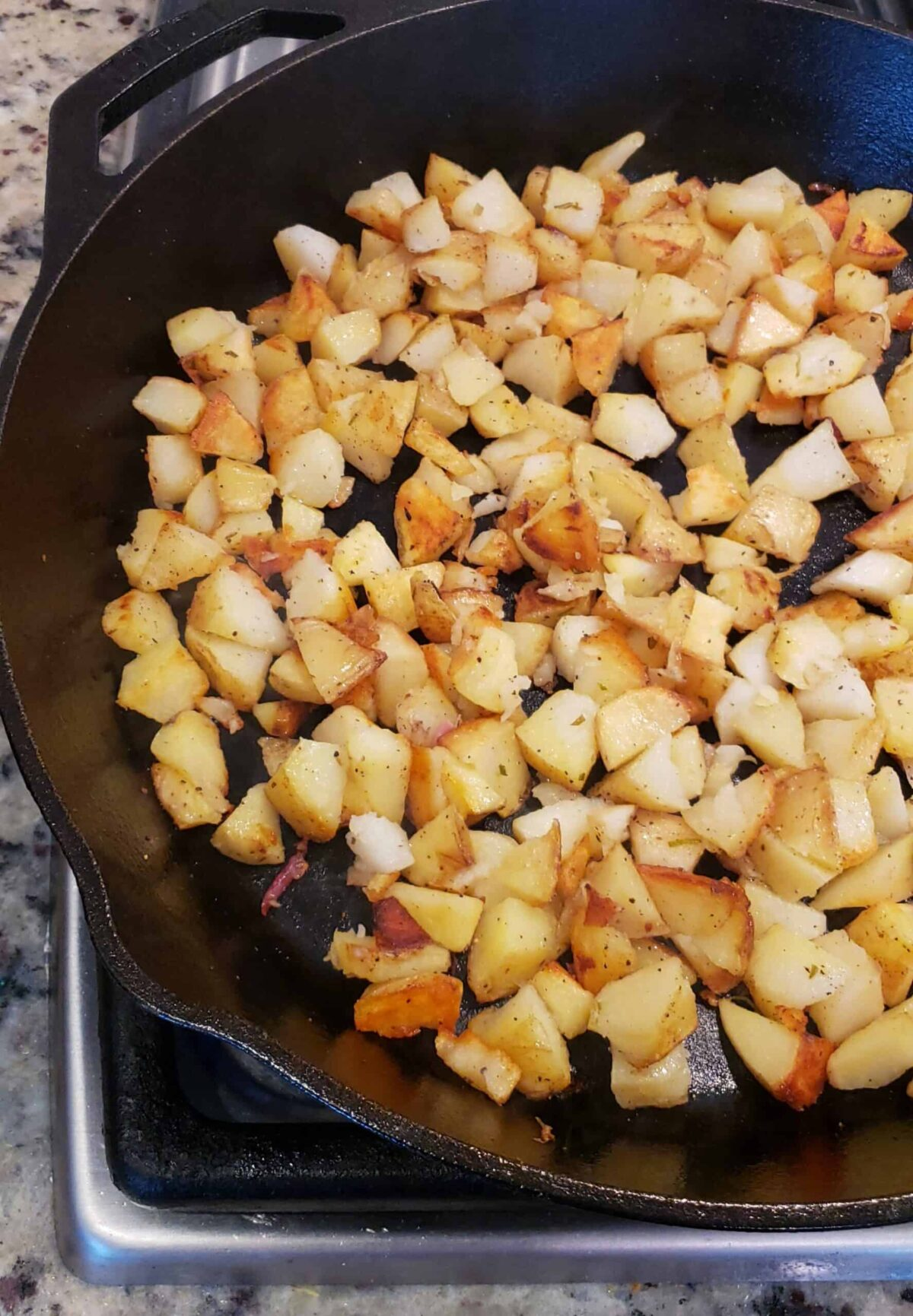 Remove the onion to a small bowl and turn the heat up to medium-high. Wait until the cast iron skillet is very hot. Add the chopped potatoes for hash.