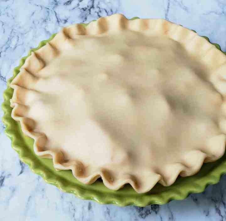 Shortcut Strawberry Rhubarb Pie. Crimping pie crust is easy when you push your thumb between two fingers and slightly pinch the pie dough together to form a zig zag.