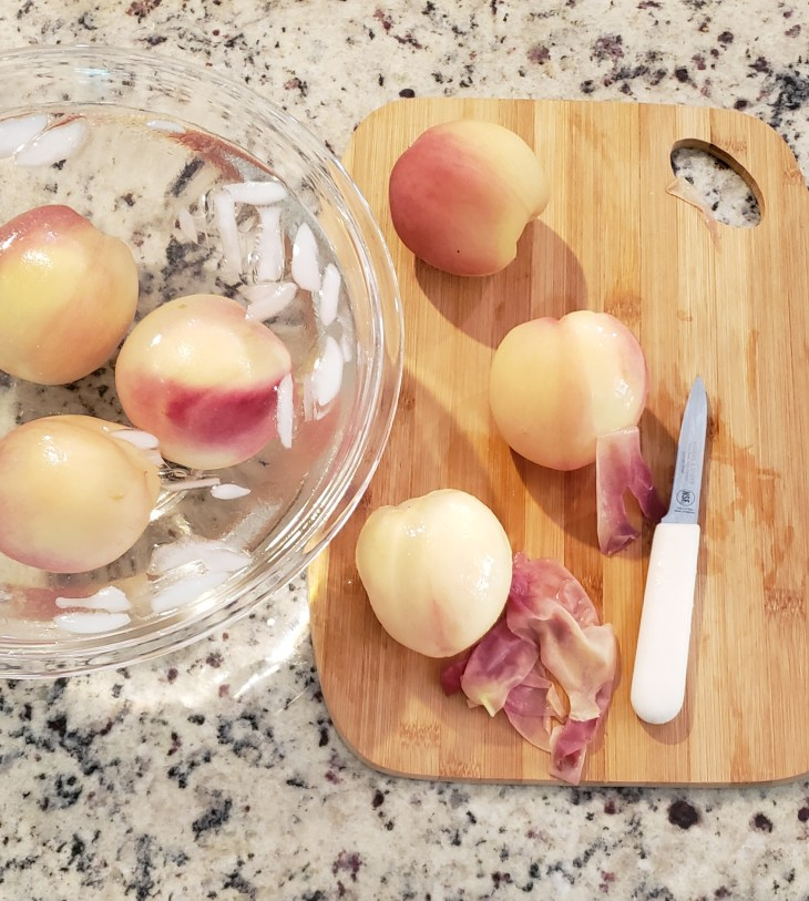 Blanch peaches for easy peeling and the skins will just pull right off. Shock them in ice water after boiling 30 seconds.