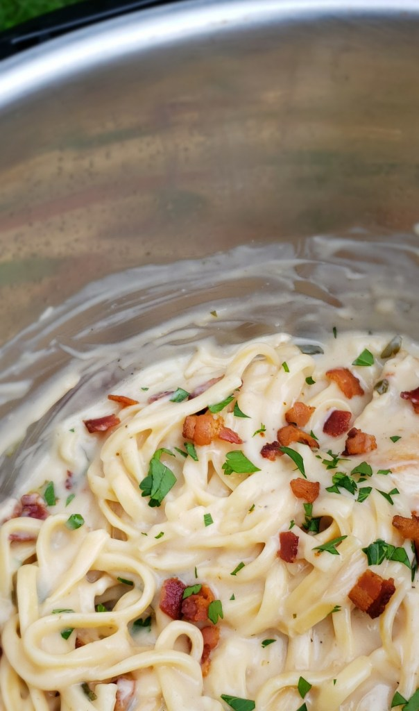 Linguine pasta alfredo sauce with bacon and parsley in an Instant Pot