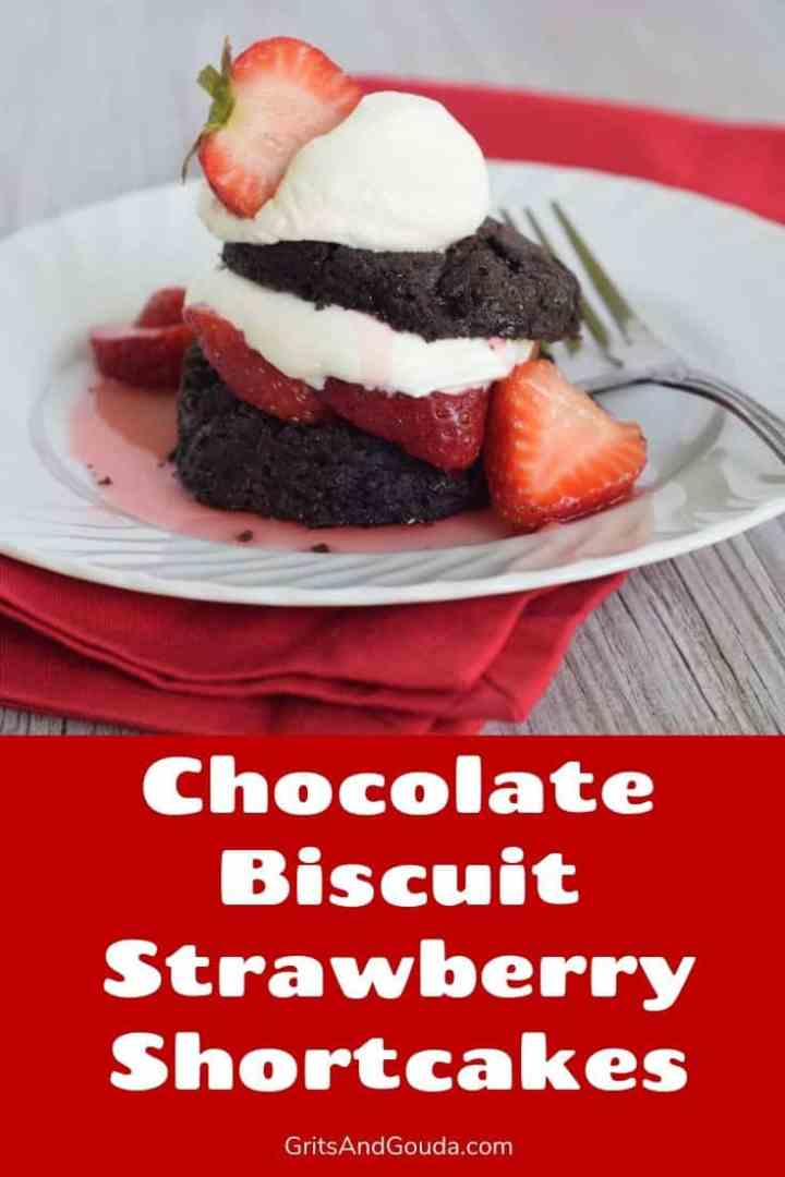 strawberry shortcakes made with chocolate biscuits served on a white plate on a red napkin