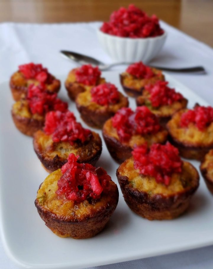 Cornbread dressing baked in mini muffin cups topped with Cranberry salsa