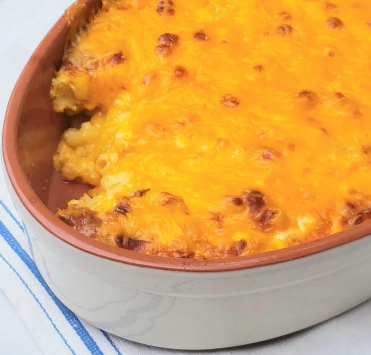 baked macaroni and cheese in tan baking dish