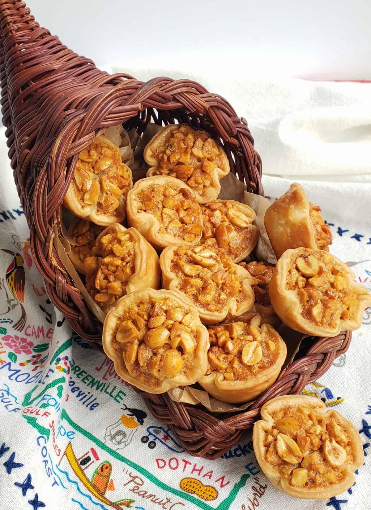 mini nut pies in a brown cornucopia