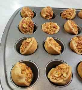 Peanut tarts tilted in mini muffin pan