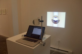 Laura Splan. autologousReflection, 2015. Processing, MacBook Pro, projector, mirror, stand, pedestal