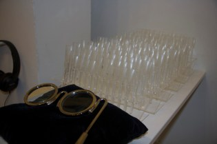 Detail from: Liss LaFleur, TIPS 667 laser cut acrylic nails with 12 custom stands, 2 pillows and 2 pairs of nickel lorgnettes, Video performance with sound on headphones