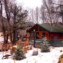 """The very cute """"Coffee on the Rocks"""" cafe we stopped by on the way to Estes Park. It had a whole frozen river and sort of forest behind it."""