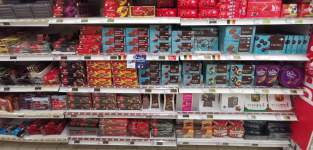 Store shelves with chocolate brands