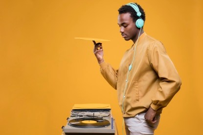 black-man-posing-with-headphones_23-2148171685