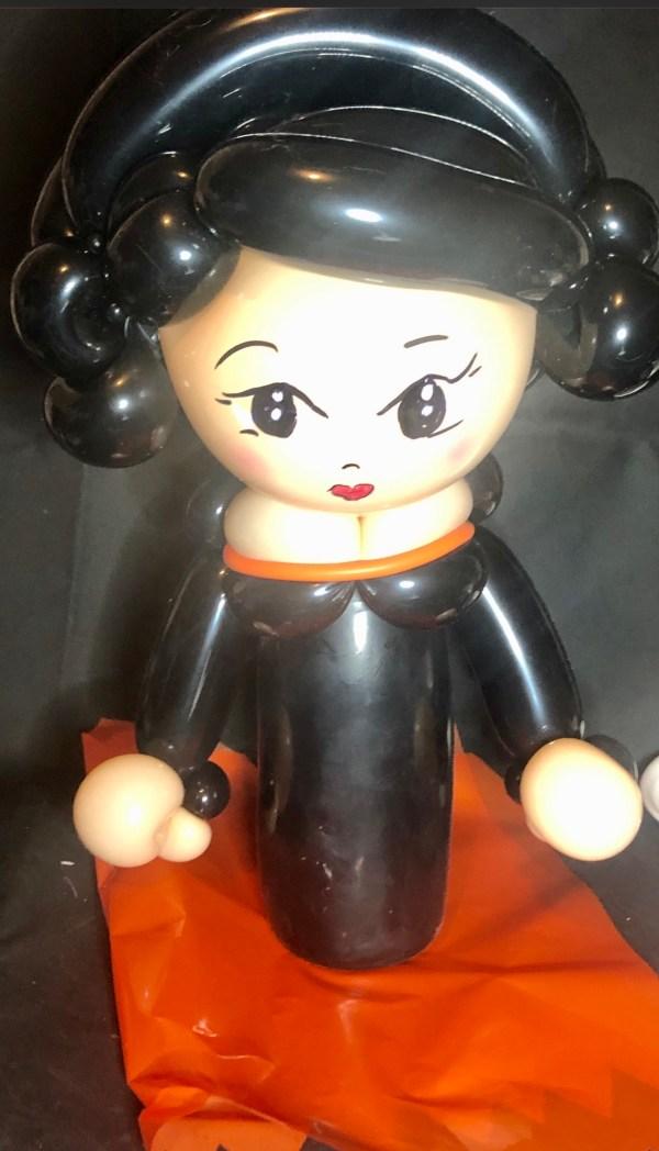 Bottle buddy lady in black