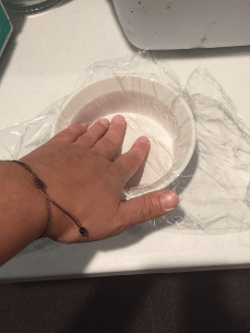 First I prepared some corning ware dishes by covering with plastic wrap. You do not have to do this step if you are using containers appropriate for dye.