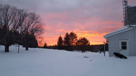 Just got the keys to the farm. It is officially ours now. The ground is still covered in snow but the sunset is magnificent.